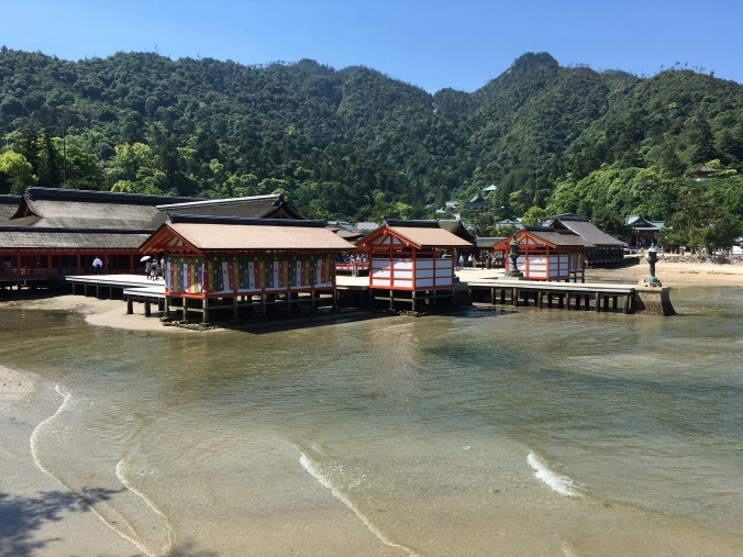 The sacred mountains on Miyajima Island form a stunning backdrop to Itsukashima Shrine. On this special day five-coloured banners were displayed at the Shrine. Colours that most likely represent the five phases/elements (Gogyo).