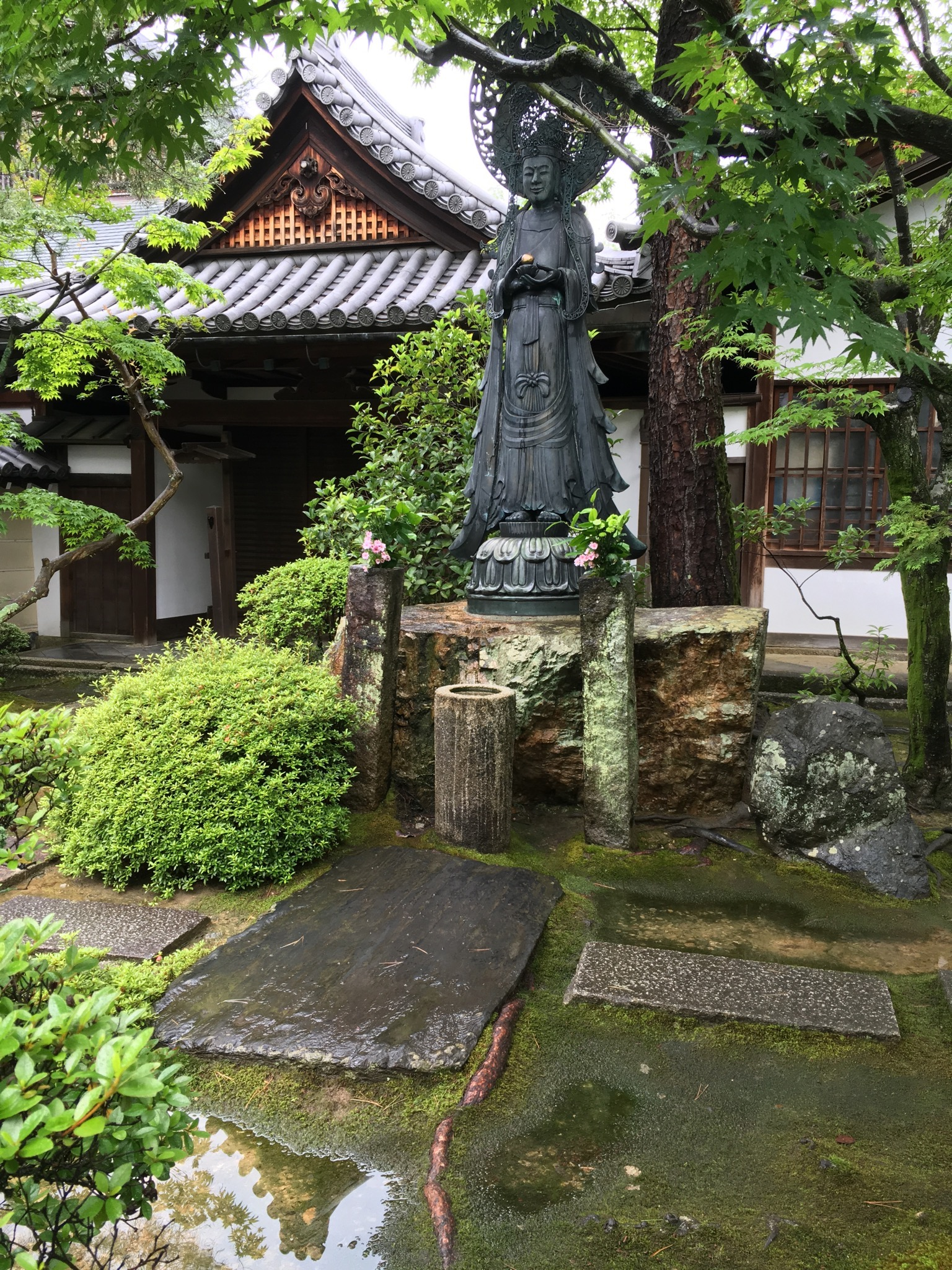 This image at Reiun-in Temple was taken an hour after it rained. There is a greenness, lusciousness and vibrancy to the vegetation that speaks of new life. The water droplets on the leaves and reflections also add to the beauty of the rainy season.