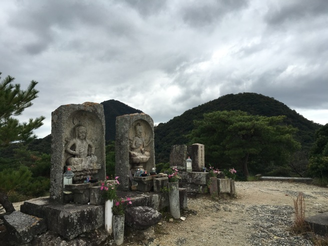 Three shrines were found at the top of the mountain, although they didn't look like the ones on the big map. To the left was Fudo Myoo, to the right a shrine to a rock, and in the middle a deity I am still confirming the identity of. The pink cosmos at the shrines were flowering everywhere I travelled in October, creating beautiful patches of delicate colour.