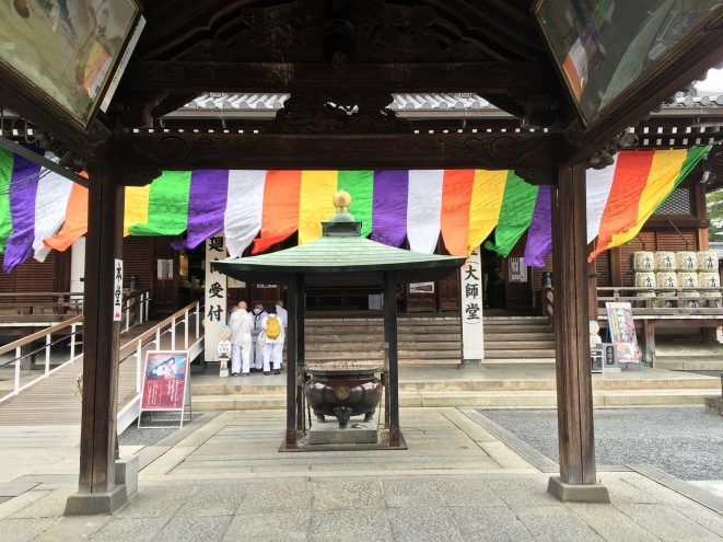 Incense burner and five coloured banner in the West Temple at Zentsu-ji.