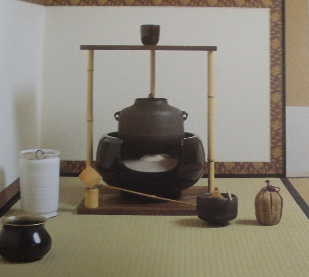 The Gogyo Dana or Five Element Table is made with two boards of cedar with the grain exposed and three bamboo pillars. The upper board represent heaven and the lower board earth with the five elements being restored between them. This information and image comes from nihonjinron.com. The site gies instructions for using the table to make both thick and thin tea.