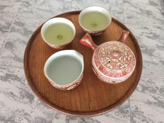 Sencha served in a Kutani-ware tea set. Every last drop of tea is meant to be poured from the tea pot, the last one being the best.