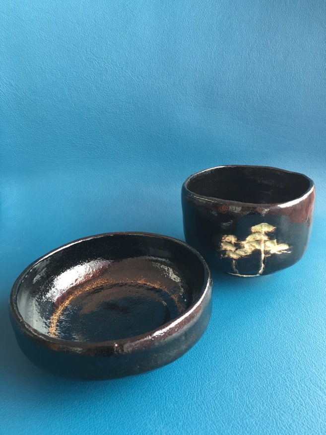 The Shoraku tea bowls are designed for use in summer (the wide low bowl) and winter the high tea bowl with the pine trees. Both come from a kiln in Kameoka near Kyoto.